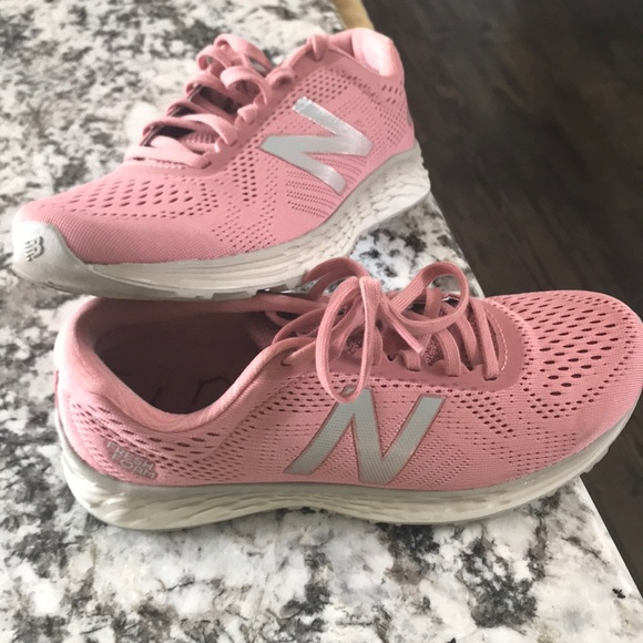 f2545f4ff5 Pink and gray NewBalance lightweight tennis shoes.